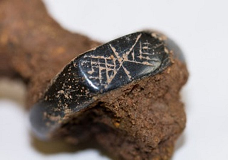 Jet ring decorated with possible early Christian symbol.