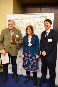 Richard Buckley (left) receives his award from Dr Denise Allen of Andante Travels (middle) and Matt Symonds, editor of Current Archaeology (right).