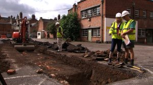 Archaeologists remove the car park and the remains of Victorian buildings with a digger to reach the medieval archaeology beneath.