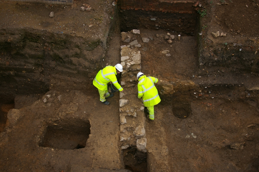 Archaeologists excavate the north-south Roman wall found on the site.