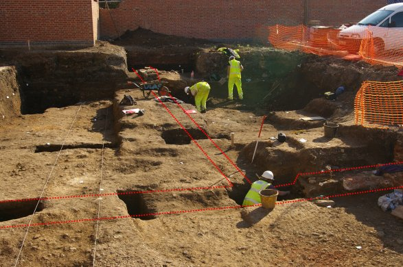 Archaeologists excavating the remains of a Roman building on the Friars Mill site in Leicester (building footprint highlighted in red)