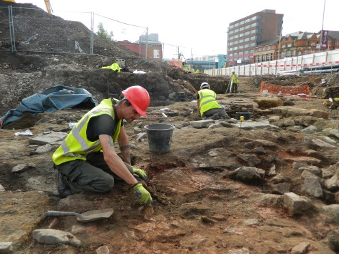 Late Roman industrial features are painstakingly excavated and recorded by archaeologists before building work begins.
