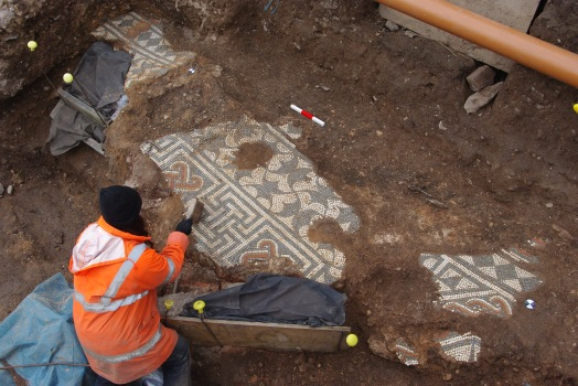 Archaeologists excavate the high-status mosaic floor.