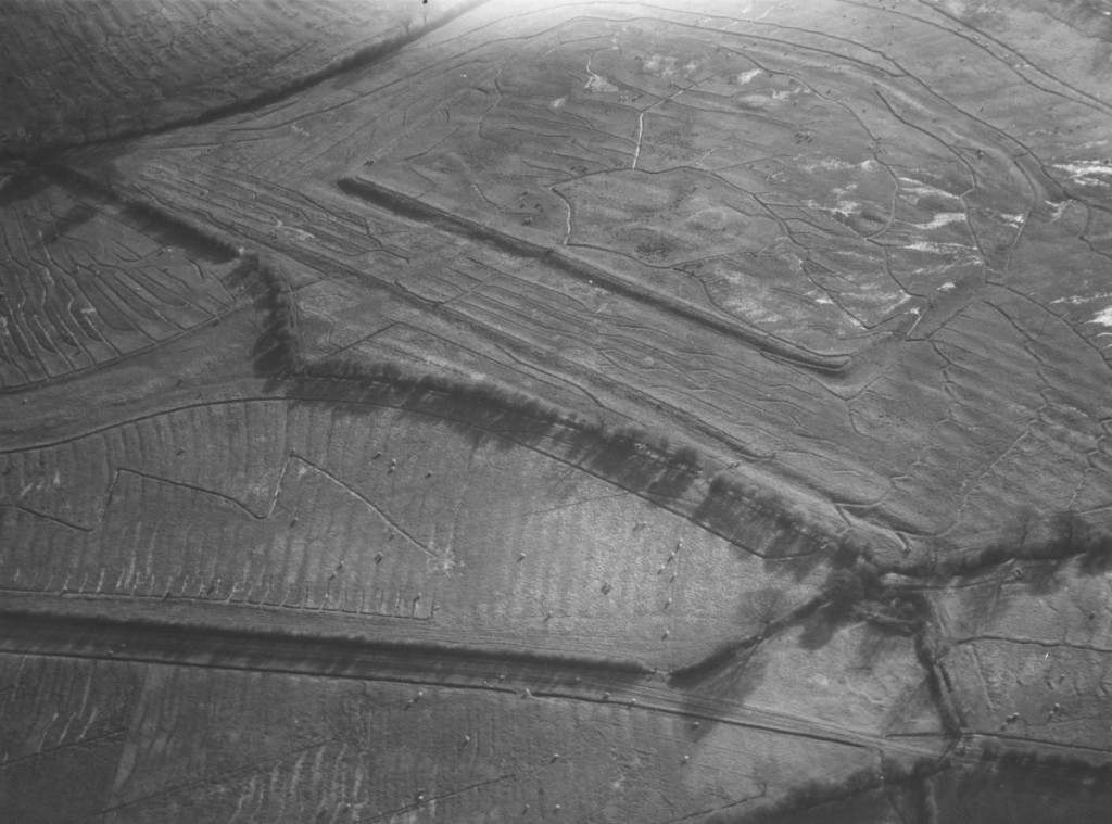 An aerial photograph of the Castle Hill monument from the north-east during is use as a sewage farm in the 1960s.