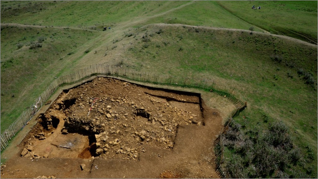 The hillfort entrance passage during excavation in 2011, showing the stone construction of the rampart and the guard chamber. Image: ULAS
