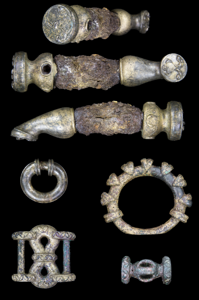 Top: Three views of one of the lynch pins from the Burrough Hill hoard, showing the detail of the decoration. Below: Terret rings and harness gear from the hoard. Image: ULAS